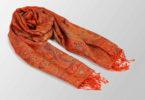 pomaranczowy szal jedwabny z orientalnym wzorem